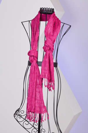 Pink Scarf Woven With Fringes On A Mannequin.