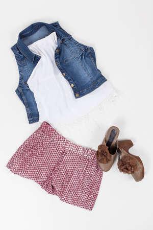 Set Of Women Clothing; Blouse, Vest, Shorts And Shoes On White Background. Imagens