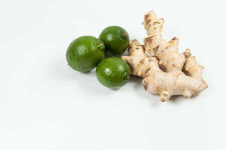 Ginger and lemons root; photo on neutral background.