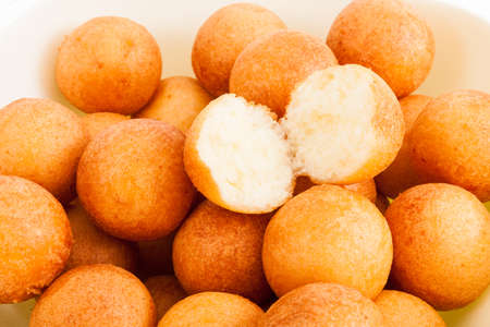 Traditional Colombian Buñuelo - Deep Fried Cheese Bread On White Background. Stock Photo