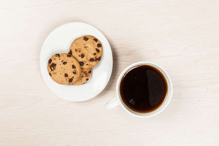A Cup Of With Coffee Accompanied With Cookies; Photo On Wooden Background.