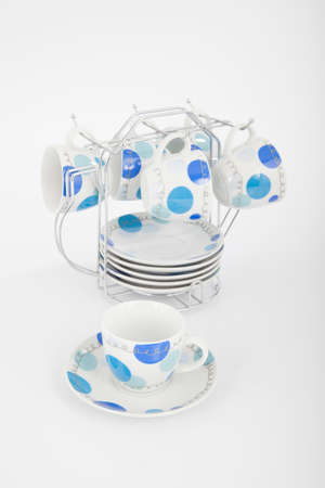 Mugs Set With Dishes On White Background.