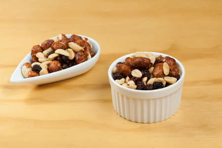 Healthy And Tasty Snack; Mixture of peanuts, raisins, and peanuts Covered With Honey. Stockfoto