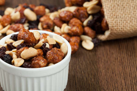 Healthy And Tasty Snack; Mixture of peanuts, raisins, and peanuts Covered With Honey. Foto de archivo