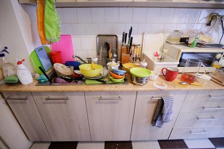 Dirty dishes in a domestic kitchen Stock Photo