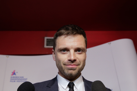 BUCHAREST, ROMANIA - APRIL 27: Romanian born actor Sebastian Stan, known for his role of Bucky BarnesWinter Soldier in the Marvel Cinematic Universe, meets his fans in a cinema, on April 27, in Bucha 에디토리얼