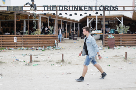 VAMA VECHE, ROMANIA - MAY 1, 2018: Garbage (especially empty bottles), after an all night party, early in the morning just before sunrise