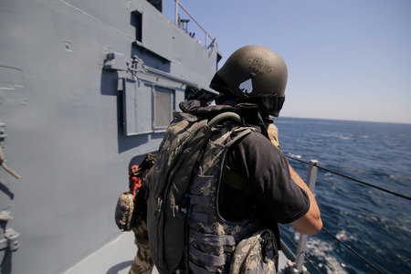 CONSTANTA, ROMANIA - JUNE 20, 2018: Romanian special forces marines get on the deck of 'Regele Ferdinand' frigate during a drill exercise, on June 20 Redakční
