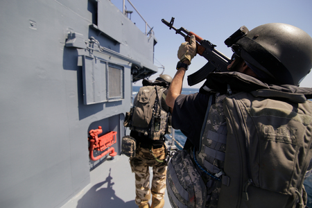 CONSTANTA, ROMANIA - JUNE 20, 2018: Romanian special forces marines get on the deck of 'Regele Ferdinand' frigate during a drill exercise, on June 20