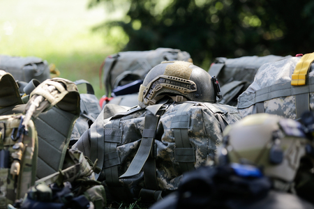 CONSTANTA, ROMANIA - JUNE 23, 2018: Equipment of Romanian military paratroopers lay on the ground before a jump, on June 23