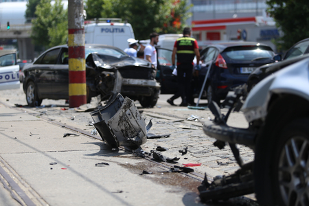 BUCHAREST, ROMANIA - JULY 13: Several vehicles are damaged on the road after a collective car accident, on July 13