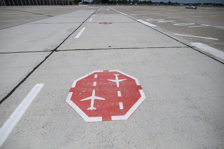 Traffic sign painted on the taxiway on the runway of an international airport