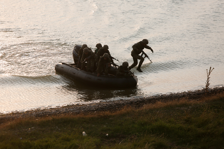 Romanian special forces military take part at a drill, near the Razim Lake, south eastern Romania, on June 24. Stock Photo