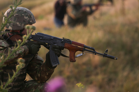 BABADAG, ROMANIA - June 24, 2018: Romanian special forces military take part at a drill, near the Razim Lake, south eastern Romania, on June 24.
