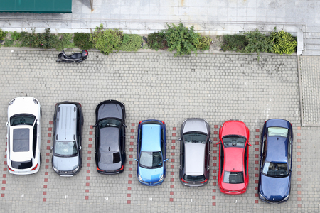 BUCHAREST, ROMANIA - July 31, 2018: Parking lot seen from above, with various type of cars