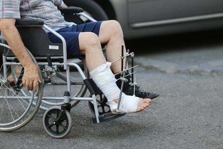 Man nurse pushing an empty wheelchair at an emergency hospital