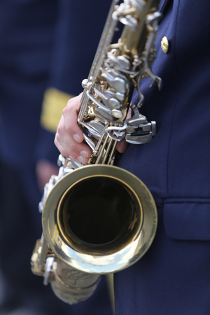 Details of a military parade band member holding a saxophone Stock Photo