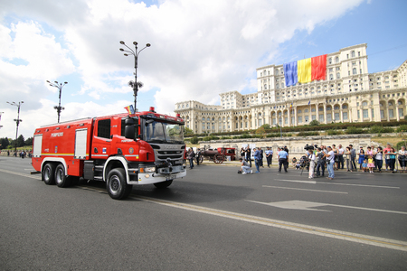 Bucharest, Romania - September 13, 2018: Romanian fire trucks parade in front of Palace of Parliament, during the Firefighters National Day, on September 13. Editorial