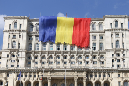 BUCHAREST, ROMANIA - September 13, 2018: Romania's flag on the Palace of Parliament, built by Ceausescu and formerly known as House of the People, on September 13. Editorial