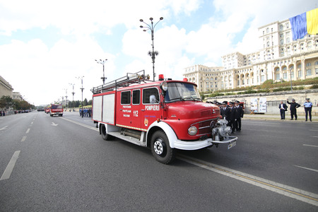 Bucharest, Romania - September 13, 2018: Vintage firefighter trucks parade in front of Palace of Parliament, during the Firefighters National Day, on September 13. Stock Photo - 122359328