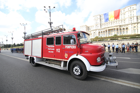 Bucharest, Romania - September 13, 2018: Vintage firefighter trucks parade in front of Palace of Parliament, during the Firefighters National Day, on September 13.