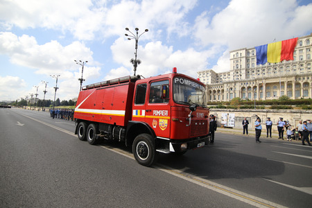 Bucharest, Romania - September 13, 2018: Vintage firefighter trucks parade in front of Palace of Parliament, during the Firefighters National Day, on September 13. Stock Photo - 122359332