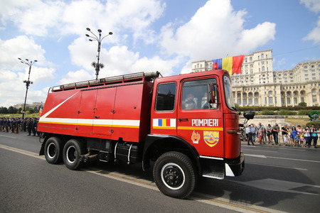 Bucharest, Romania - September 13, 2018: Vintage firefighter trucks parade in front of Palace of Parliament, during the Firefighters National Day, on September 13. Stock Photo - 122359333