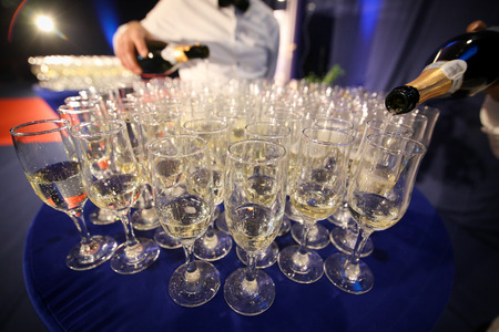 Details with glasses of champagne awaiting to be served to people arriving at a luxurious party Banco de Imagens