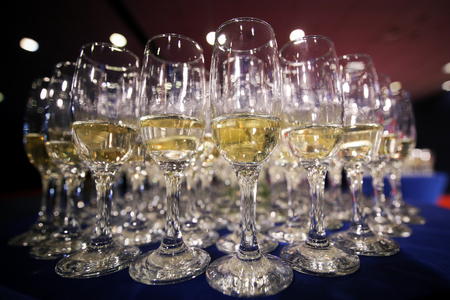 Details with glasses of champagne awaiting to be served to people arriving at a luxurious party Foto de archivo