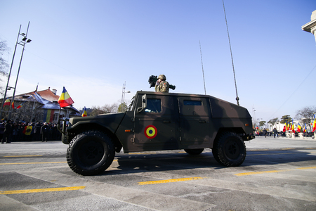 BUCHAREST, ROMANIA - December 1, 2018: URO VAMTAC combat armored vehicle, at Romanian National Day military parade passes under the Arch of Triumph