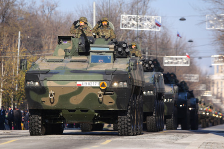 BUCHAREST, ROMANIA - December 1, 2018: Driver of a Piranha V PC 8x8 armored vehicle at Romanian National Day military parade Sajtókép