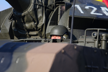 "BUCHAREST, ROMANIA - December 1, 2018: The driver of a TR 85 M1 ""Bizonul"" (The Bison) armored military heavy tank  at Romanian National Day military parade Editorial"