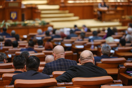 BUCHAREST, ROMANIA - December 12, 2018: Romanian member of Parliament is taking part at a meeting in the Chamber of Deputies Editorial