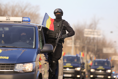 Bucharest, Romania - December 1, 2018: Anti terrorist officer from the Romanian Intelligence Service, armed with a MP7 Heckler & Koch Submachine Gun, at the Romanian National Day military parade.