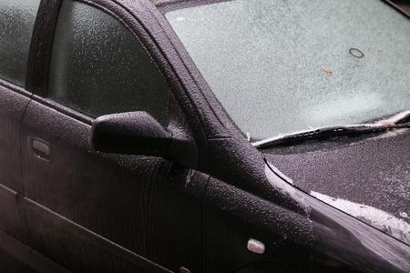 Car frozen windscreen and windscreen wipers after a freezing rain phenomenon