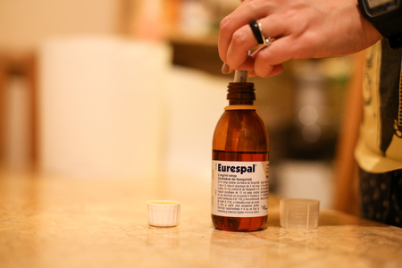 Bucharest, Romania - February 14, 2019: Details with a bottle of Eurespal  (in Romania, also known as Pneumorel in France) children cough syrup