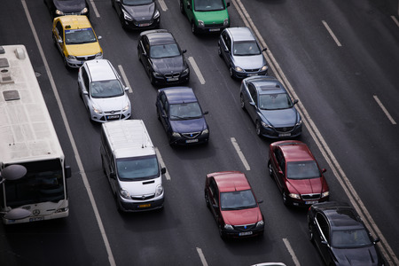 Bucharest, Romania - February 26, 2019: Cars in traffic on a boulevard seen from above, in Bucharest.