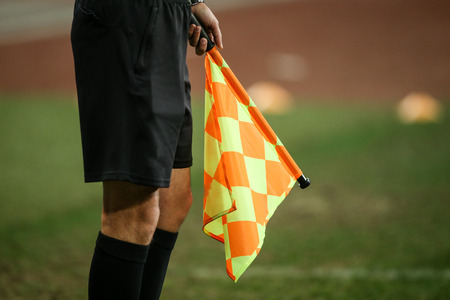 Details of a linesman referee during a soccer game Stock Photo
