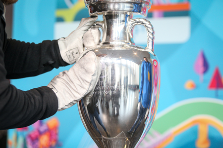 Bucharest, Romania - March 16, 2019: The original UEFA Euro 2020 tournament trophy is being cleaned before being presented to the public on the National Arena Stadium in Bucharest.