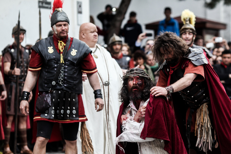 Bucharest, Romania - April 15, 2014: Dramatisation by actors of the Passion of Christ - drama, torture and crucifixion of Jesus Christ by the Romans. Editorial