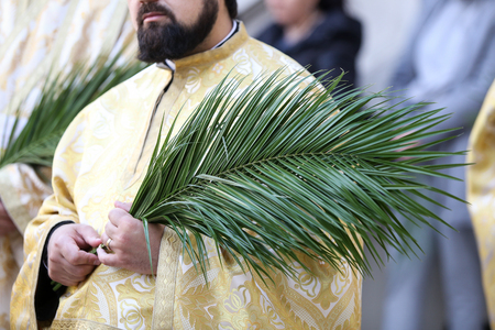 Bucharest, Romania - April 20, 2019: Romanian Orthodox priests during a Palm Sunday pilgrimage procession in Bucharest