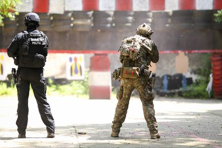 Bucharest, Romania - June 10, 2019: a Romanian SIAS (equivalent of SWAT in the US) police officer and a special forces soldier train together in a shooting range.
