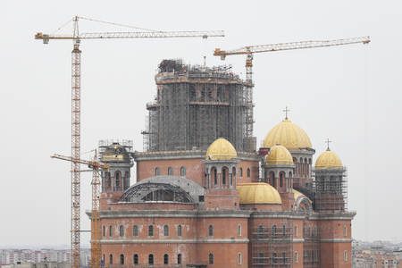"""Bucharest, Romania - February 22, 2019: Construction site of """"Catedrala Mantuirii Neamului"""" (Peoples Salvation Cathedral), an christian orthodox cathedral in Bucharest, Romania Editorial"""
