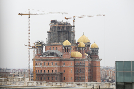 """Bucharest, Romania - February 22, 2019: Construction site of """"Catedrala Mantuirii Neamului"""" (Peoples Salvation Cathedral), an christian orthodox cathedral in Bucharest, Romania"""