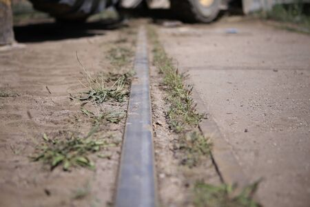 Close up image with an old train rail in the middle of the city