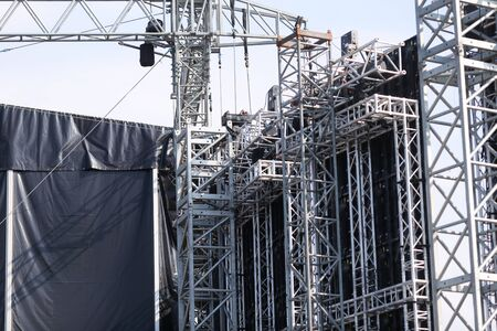 Details with the metallic structure of a large concert stage seen from behind, at a music festival