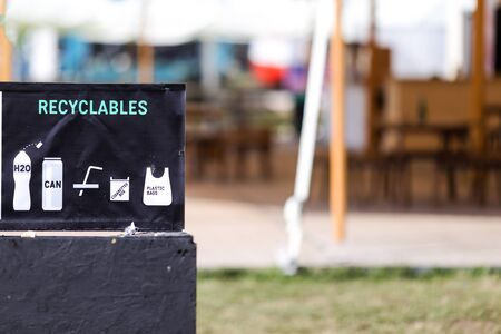 Recycling symbols on garbage bins (compostables and recyclables)