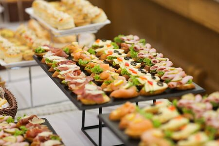 Shallow depth of field image with appetizers on a table at an event, provided by a catering company