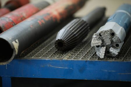 Details with the old and rusty heavy iron drill heads used in the oil and gas industry