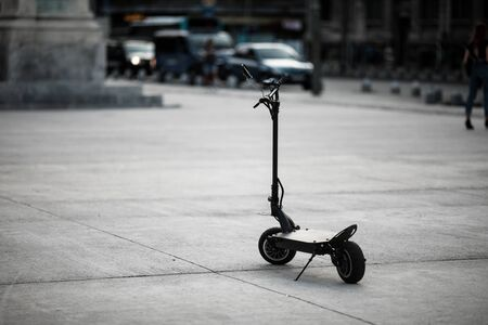 Shallow depth of field image with a parked electrical scooter in downtown Bucharest Imagens